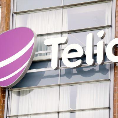 Telian logo talon seinässä.