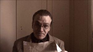 Alfred Backa i gammal kostym.