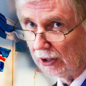 Erkki Tuomioja framför nordiska flaggor