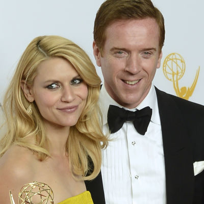 US actress Claire Danes (L) and British actor Damian Lewis (R) hold the awards for Outstanding Actress and Actor in a Drama Series for their roles in 'Homeland' at the 64th Primetime Emmy Awards in Los Angeles, California, USA, 23 September 2012. The Prim
