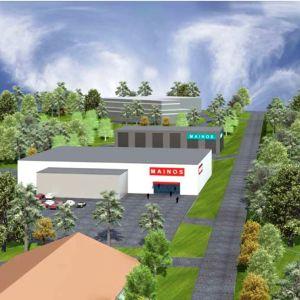 Ett bildmontage som visar hur fyra stora låga affärs- och andra hus placeras på ett område. Husen omges av parkeringsområden och parkaktig skog.