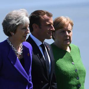 May, Macron och Merkel under G7-mötet i Kanada 2018.