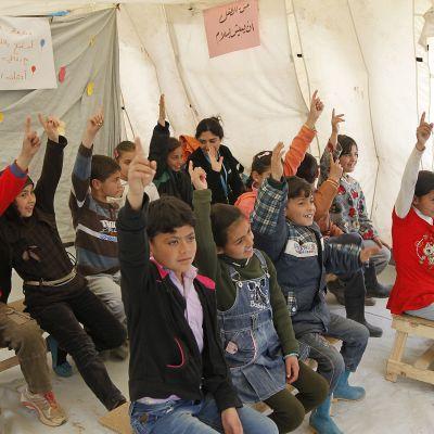 Syyrialaislapsia Unicefin koulussa Bekaanlaaksossa Libanonissa maaliskuussa 2015.