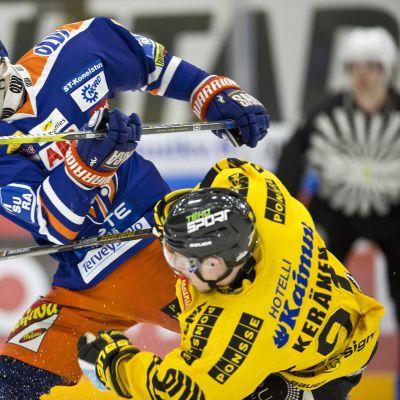 Teemu Nurmi ja Janne Keränen suorittavat omaa kamppailuaan.