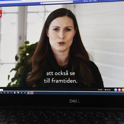 Kuvassa Sanna Marin puhuu virtuaalivappulähetyksessä.