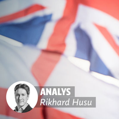 Bild på den brittiska flaggan i förgrunden och Big Ben i bakgrunden