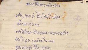 Ett meddelande som en av pojkarna som sitter fast inne i Tham Luang-grottorna skrivit till sina föräldrar.