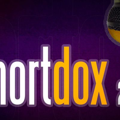 Shortdox tekstin päälle valuu mikrofonista oranssia maalia