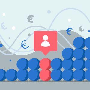 Staplar med färgade bollar. I bakgrunden finns euro-symboler.