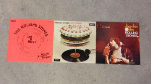 Tre olika fodral för Rolling Stones Let it Bleed