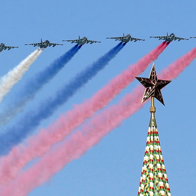 Russian Su-25 assault aircrafts release smoke in the colours of the Russian flag while flying above the Kremlin, during the rehearsal for the Victory Day military parade at the Red Square in Moscow, Russia, 07 May 2015.