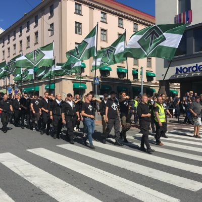 "Nordic Resistance Movement marchers chant ""Free speech!"" in Turku on 18 August 2018."