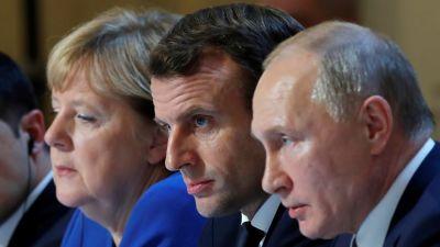 Tysklands Angela Merkel, Frankrikes Emmanuel Macron och Rysslands Vladimir Putin.