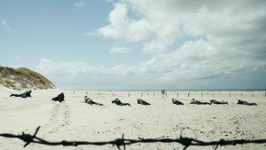 Under sanden