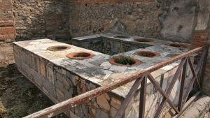 Matservering med i antikens Pompeji.