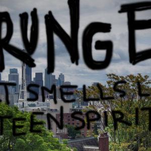 """Stadsvy från Seattle med texten """"Grunge Kurt smells like teen spirit""""."""