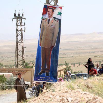 Assadin kuva rajalla