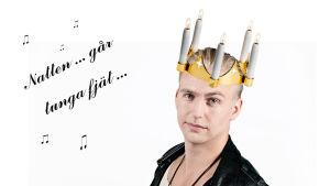 Janne Grönroos med en luciakrona på huvudet.