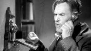 Mies puhuu puhelimeen (1957)