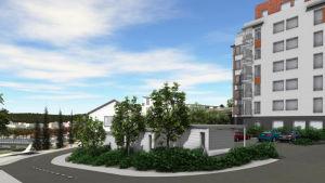 En vy över ett planerat flervåningshus med parkeringsområde.