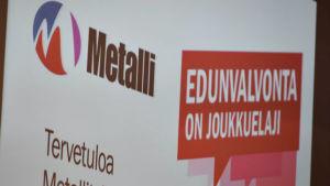 Affiasch som välkomnar till Metalls fullmäktige.