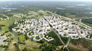 En plankarta från luften över hus ritade längs en järnvägen. Bilden är tecknad.