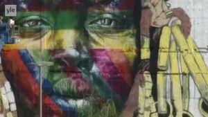 Uutisvideot: Olympiarenkaat inspiroivat 3000 neliön seinämaalauksen Rion kaduille