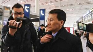 Choi Kang Il Pekingin lentokentällä 18. maaliskuuta.