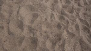 Uimarannan hiekkaa.
