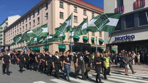 "Nordic Resistance Movement marchers chant ""Free speech!"" in Turku on 18 August 2018."