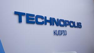 Technopolis Kuopio teksti seinässä.