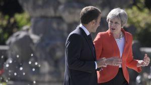 Theresa May ja Ranskan presidentti Emmanuel Macron neuvottelevat Salzburgin huippukokouksessa 20. syyskuuta.