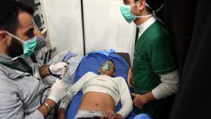 Aleppossa hengitysvaikeuksista kärsiviä potilaita.