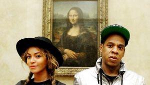 Beyoncé ja Jay-Z Leonardon Mona Lisan edustalla.