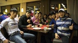 Tyytyväiset kiinalaisurheilijat