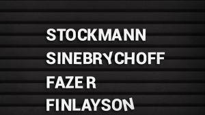 Mustassa nimitaulussa valkoisella nimet: Stockmann, Sinebrychoff, Fazer ja Finlayson.