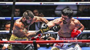 Vasenkätisenä otellut Manny Pacquiao (oik.) teki komean uran nyrkkeilijänä ennen siirtymistään Filippiinien politiikkaan. Tässä hän ottelee argentiinalaisen Lucas Matthyssen kanssa Kuala Lumpurissa viime vuoden heinäkuussa.