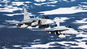 Ruotsalainen Gripen ja suomalainen F-18 hornet taisteluhävittäjä