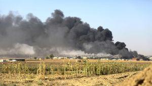 Ras al-Ainin rajakaupungista nousi savua 12. lokakuuta.
