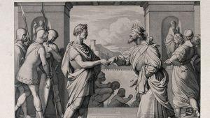 Etsaus kahden toogaan pukeutuneen miehen kättelystä. Ympärillä on sotilaita ja muuta väkeä.