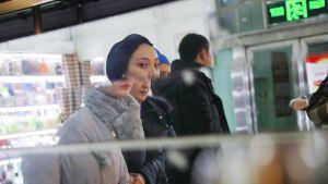 Uiguurinainen basaarissa.