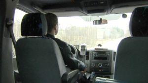 Taksikuski työssään