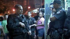 Kaksi poliisia öisellä kadulla kivääreineen