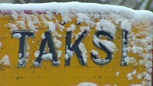 Luminen taksi-kyltti