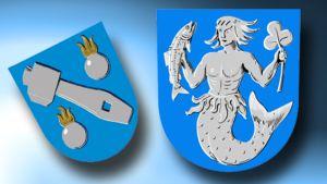 Oravaisten vaakuna vasemmalla, oikealla Vöyri-Maksamaan vaakuna.