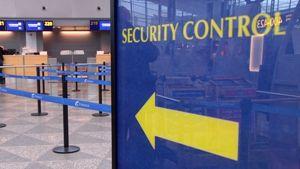 Turvatarkastukseen ohjaava kyltti lentokentällä.
