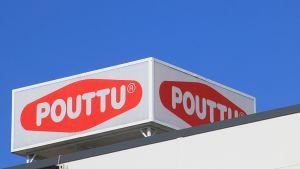 Kuvassa kyltti Poutun katolla.