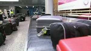 Laukkuja lentokentällä