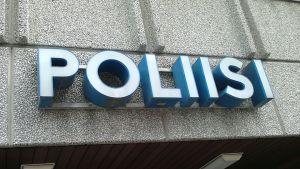 Poliisi-seinäkyltti