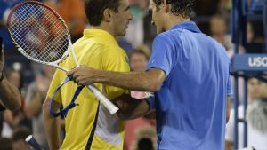 Tommy Robredo ja Roger Federer.